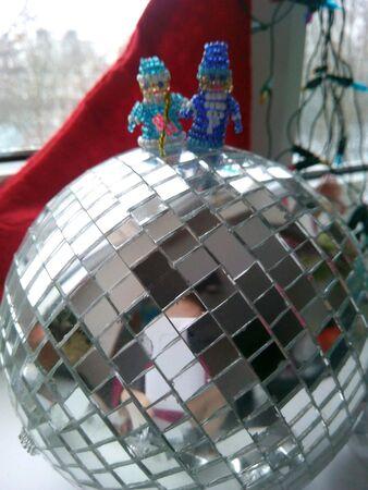 'snow maiden': Santa Claus and Snow Maiden on the mirror balls Stock Photo