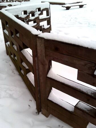 fence: Wooden fence in snow background Stock Photo