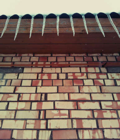 icicles: Icicles on a brick wall background