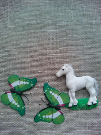 decor: Decor white horse and butterflies Stock Photo