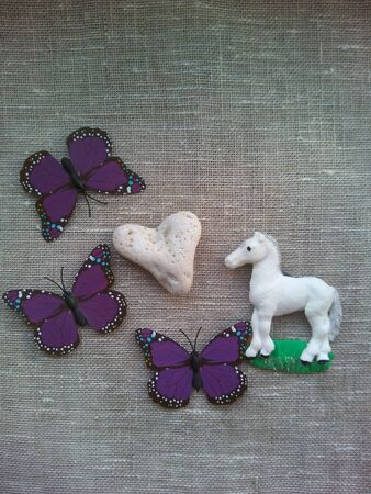 decor: Decor white horse,stone heart and butterflies