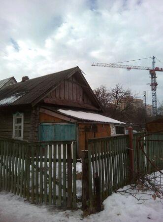 minsk: Old wooden house and crane in Minsk