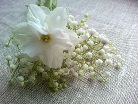 decor: Lilies of the valley and narcissus flowers natural background