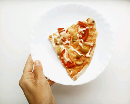 colorful: Pizza homemade in the hand on a plate white background