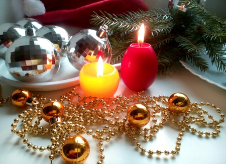 silver: Christmas decorations balls and burning candles