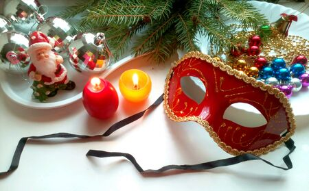 silver: Christmas decorations mask, balls and burning candles
