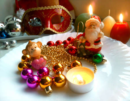 silver: New years and christmas decorations monkey, balls and burning candles Stock Photo