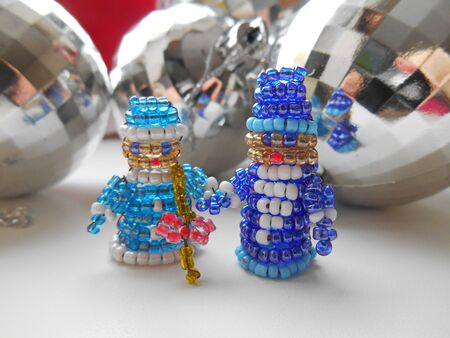 snow maiden: Santa Claus and Snow Maiden Christmas decorations of beads Stock Photo