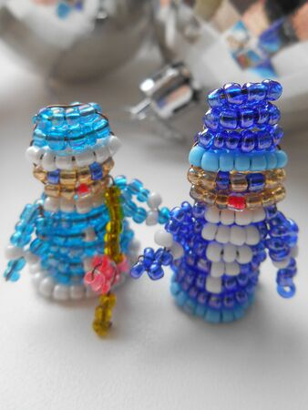'snow maiden': Santa Claus and Snow Maiden Christmas decorations of beads Stock Photo