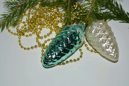 decor: Christmas and New Year decor cones on a fir branch white background