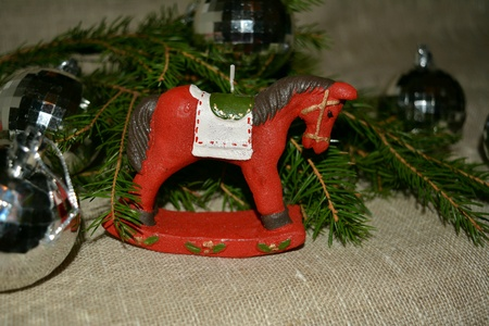 silver: Christmas and New Year candle horse on a fir branch natural background
