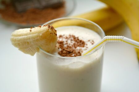 lactic: Milk shake with banana and chocolate on a white background