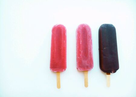 Ice cream on a stick on a white background Stock Photo