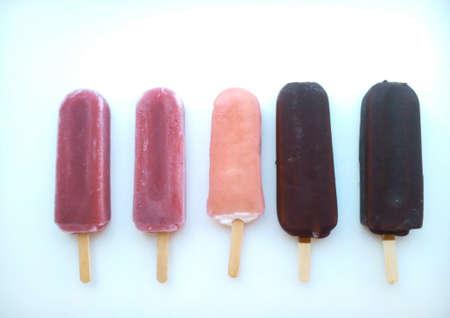 colour: Ice cream on a stick on a white background Stock Photo