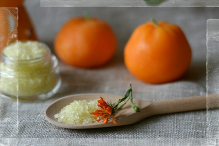 Spa sea salt bath in the wood spoon and candles tangerines