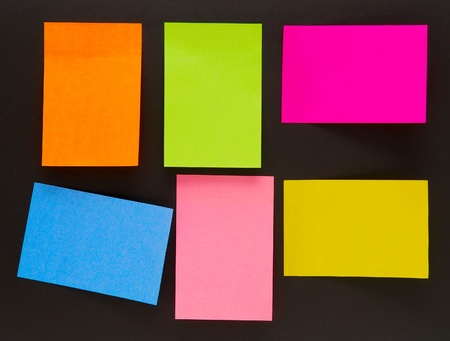 an empty color sticky notes on black photo