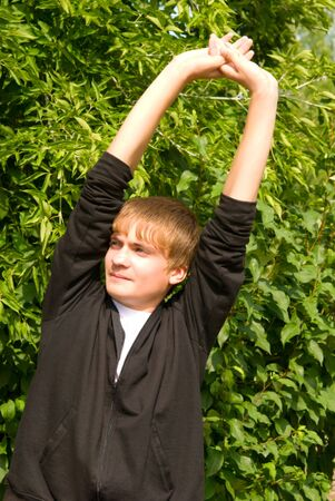 young man does warm-up in the open air Stock Photo