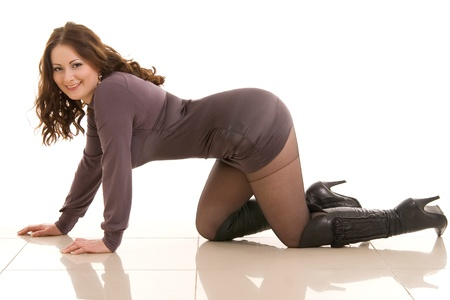 beautiful girl with a flowing hair is on all fours Stock Photo