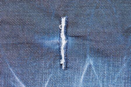 Hole on a jeans fabric  photo