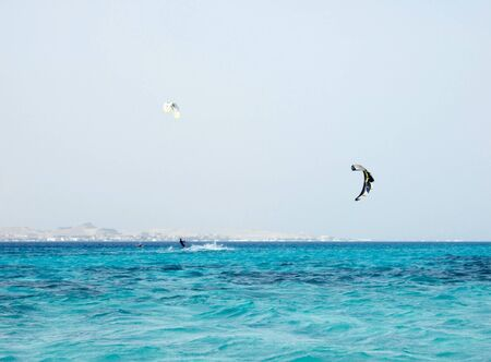 kiteboarder enjoy surfing in red sea photo