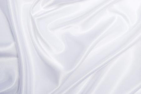 エレガントな白い絹背景のスムース