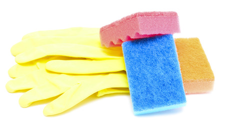 rubber gloves, sponges are isolated on a white background photo