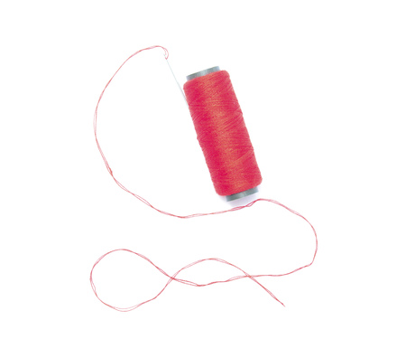 thread with a needle isolated on white background photo