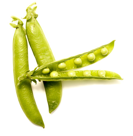 pea pods isolated on white background photo
