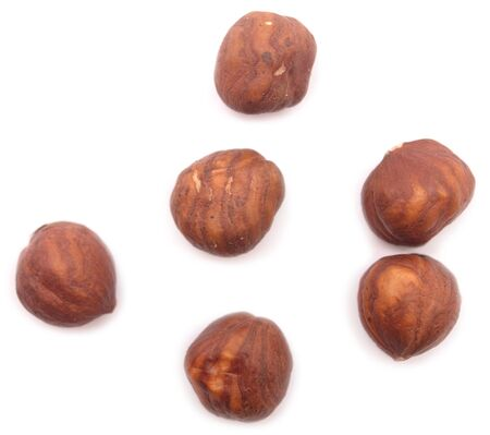 cleave: hazelnuts isolated on white
