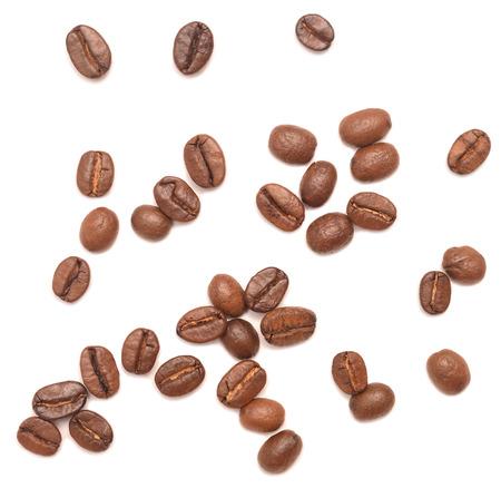 granos de cafe: los granos de caf� aislados en fondo blanco  Foto de archivo