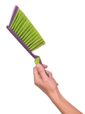 brush in: brush in female hands on a white