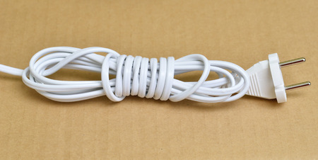plugged in: Plugged in electric devices in an extension cord Stock Photo