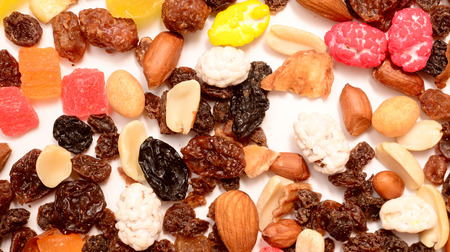 candied: Pile of toasted nuts and candied fruit background