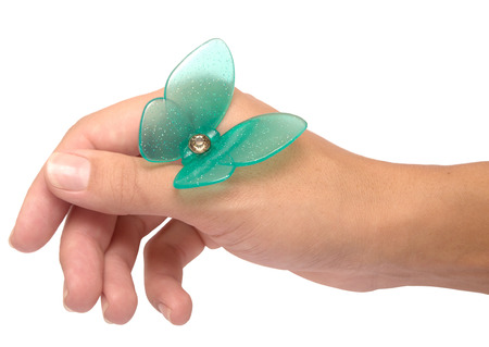 releasing: artificial butterfly on womans hand