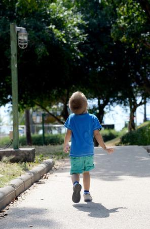 harmed: resentful little boy goes to the sea