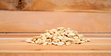 Peanuts on the wood background