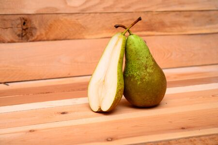 ripe pear on a wooden background
