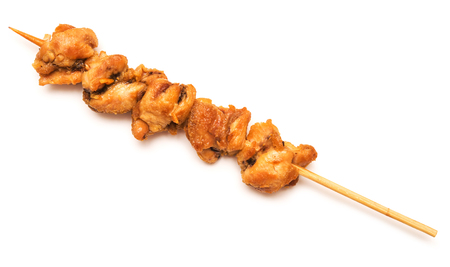Skewers of chicken on white background Imagens