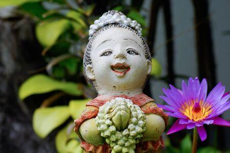 Statue Thai style and Purple lotus