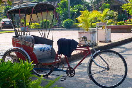 An old tricycle parking in garden Stock Photo