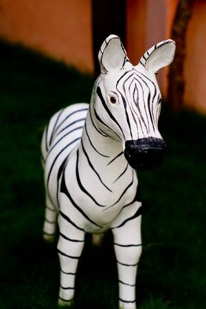 molded: molded zebra in lawn Stock Photo