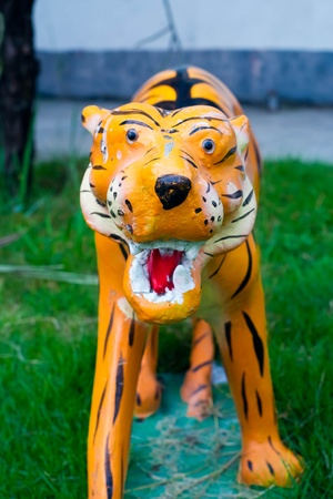 molded: molded tiger in lawn