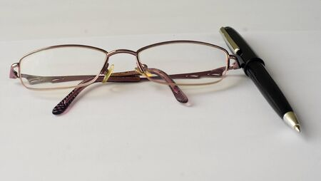 Black pen and glasses on a white background. Stock Photo - 15905506