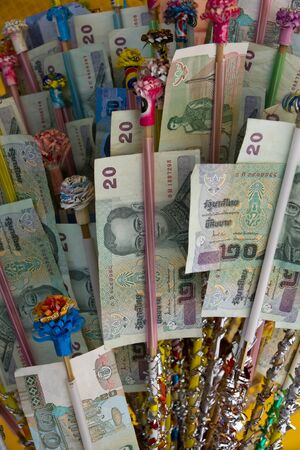 Thai money inserted in timber. Stock Photo