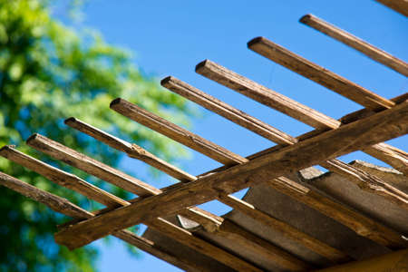 Closed up of bamboo roof and blue sky backgruand photo