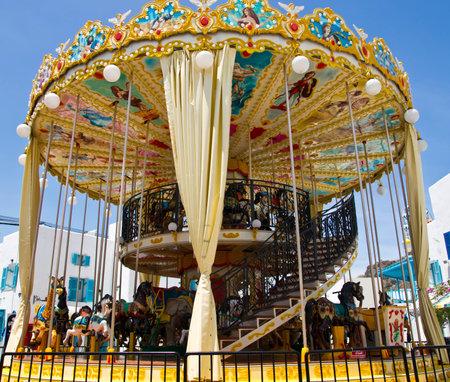 Kids toy carousel at an amusement park
