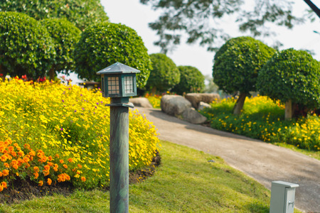 Old garden lamp in public park ,colorfull flower is background photo