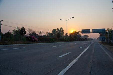 hiway: Empty hiway road with sunrise in the background