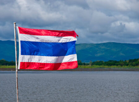 thailander flag: Thailand flag isolated with lagoon and mountains in the background