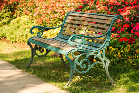 Old Bench in the park garden ,old wood and steel